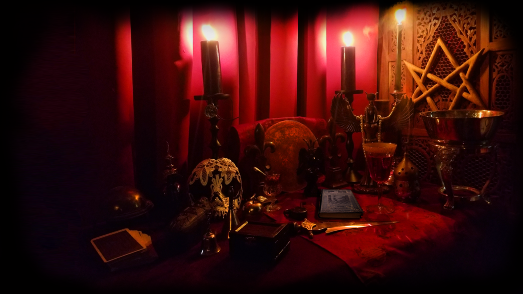 Altar with various magical implements including statue of Baphomet, Isis, Sigillum Dei Aemuth, Book of the Law